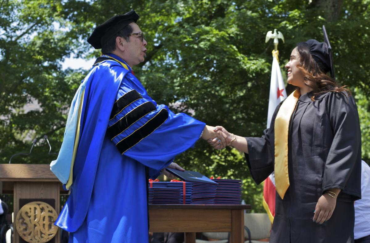 Dr. Chong and a student at graduation